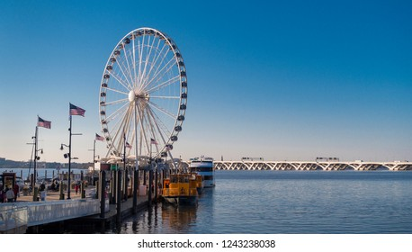 NATIONAL HARBOR, MARYLAND, USA - NOVEMBER 25, 2018: The Capital Wheel attraction, and Wilson Bridge