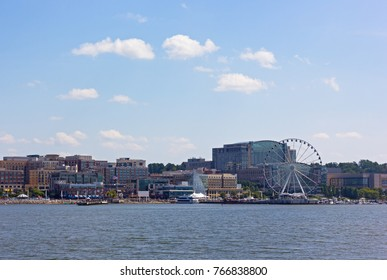 National Harbor waterfront panorama in Oxon Hill, Maryland, USA. Panorama of National Harbor with Ferris and modern buildings.