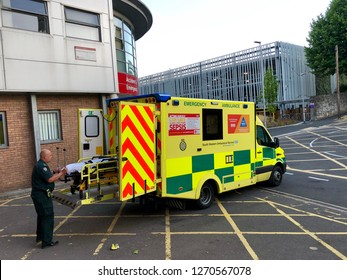 National Health Service, UK - 27th July 2018: Paramedic with a stretcher in Emergency department. Ambulance service of NHS hospitals and emergency services, Yeovil District Hospital, UK