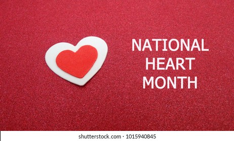 National Heart Month with red background