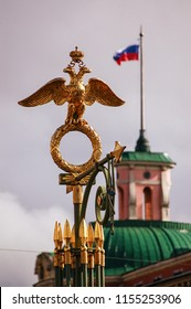 National heraldic emblem of Russia (crowned two-head eagle) in front of Russian flag