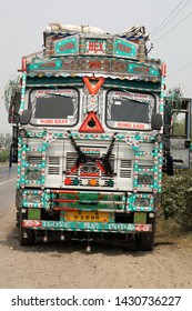 National Highway 9, Uttar Pradesh, India, May 23, 2019. Full Frontal Close Up View of a Decorative Indian Truck by the Side of the Road