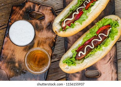 National Hot Dog Day.Traditional American hot dogs and beer on a wooden surface. Top view, copy space