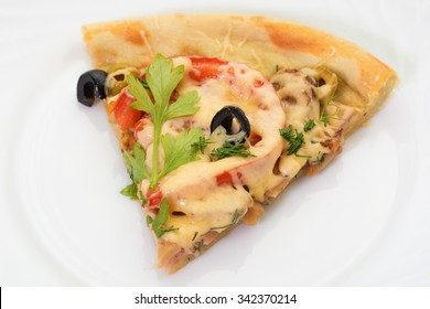 national italian food - pizza. homemade, with salami,  cheese, tomatoes, black and green olive on white plate