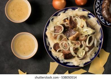 National Kazakh dish - Beshbarmak and meat bouillon