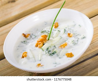 National Macedonian and Bulgarian dish Tarator - cold soup from yoghurt and cucumbers with potherbs