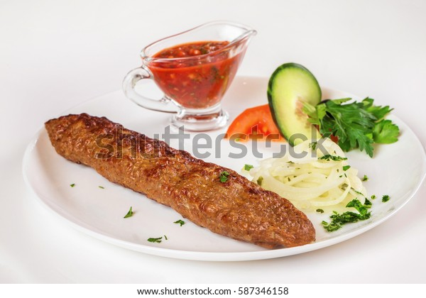 National meal beef shish kebab with sauce isolated at white background.