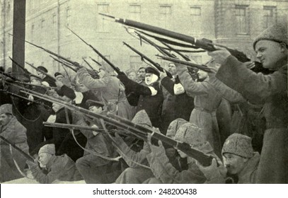 National militia firing on a Czarist police position during Russian Revolution. 1917.