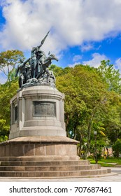 National monument of Costa Rica is a sculptural group located in the National Park of San Jose. The sculpture is cast in bronze on a pedestal, where there are five female figures carrying weapons.