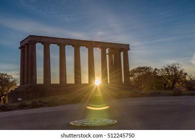 National monument of Scotland at Calton Hill, Edinburgh - beautiful panoramic image at sunrise - backlit, blue sky