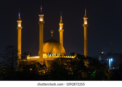 The National Mosque of Abuja illuminated during the night