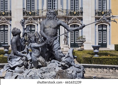 The National Palace of Queluz - Lisbon - Portugal. Neptunes Lake fountain in front of the Ceremonial Facade of the Corps de Logis designed by Oliveira.