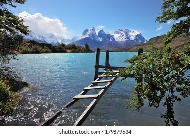 The National Park Torres del Paine, Chile. Boat dock on Lake Pehoe. On the opposite side of the lake majestic snow-capped cliffs of Los Kuernos