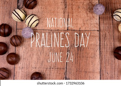 National Pralines Day. Chocolate pralines on a wooden background stock images. Different types of chocolate candies images. Pralines Day Poster, June 24. Important day