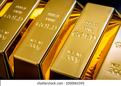 National reserve of gold, financial stability and commodity trading concept with many pure solid gold bars in a raw on black background with copy space