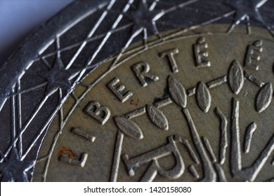 """National side of French EURO. Detail of the used 2 Euros coin. A tree symbolising life, continuity and growth encircled by the motto """"Liberté, Egalité, Fraternité"""" (Liberty, equality, fraternity)."""