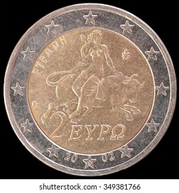 National side of two euro coin issued by Greece isolated on a black background. The greek obverse face depicts a scene from a mosaic in Sparta showing Europa being abducted by Zeus in form of a bull