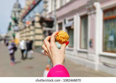 The national Tatar sweetness of the chak-chak on the background of the pedestrian street Bauman in the city of Kazan.
