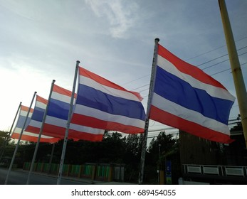 National Thai flag waving in the evening.