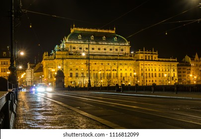 National Theatre and road on bridge with car lights in the night. Prague, Czech Republic