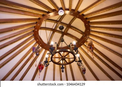 National traditional decoration of the yurt ceiling. Kazakhstani ornament. Vintage weaving of patterns. Yurt decoration. Wooden frame with patterns as an ethnic background, golden horde, Kazakhstan.