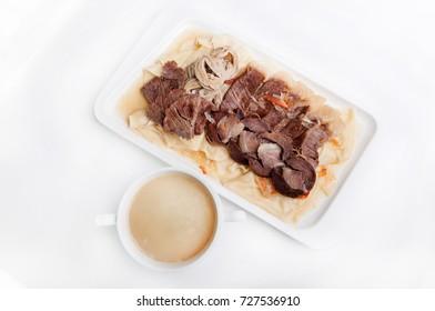national traditional Kazakh dish beshbarmak on white background