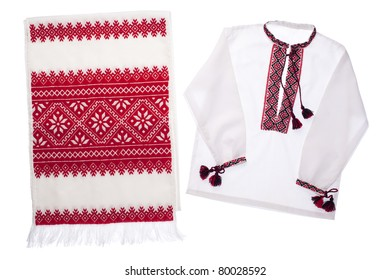 National Ukrainian traditional ornate handicraft symbol embroidery in red cross-stitch handmade white towel and cotton vyshyvanka menâ??s shirt with ornamental pattern isolated