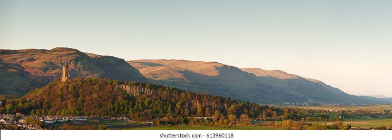 The National Wallace Monument standing on the top of Abbey Craig rock with the Ochil Hills at the background. Stirling, Scotland, UK