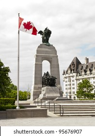 The National War Memorial with Canadian flag and the Fairmont Chateau Laurier in Ottawa, Canada.