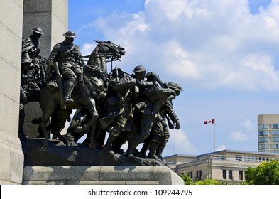 The National War Memorial known as The Response, is a granite cenotaph with bronze sculptures of 23 figures in war.