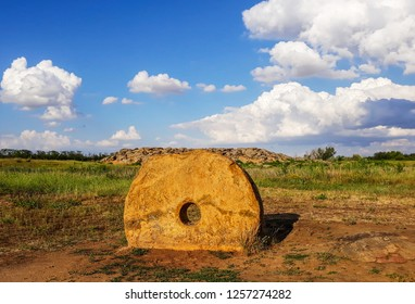 National-historical and archaeological reserve Stone Grave or Rocky Mound Kamena Mohyla near Melitopol. Ukraine. Old ancient gold millstone. Landscape archaeological reserve Stone Tomb.