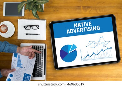 NATIVE ADVERTISING Businessman working at office desk and using computer and objects, coffee, top view,