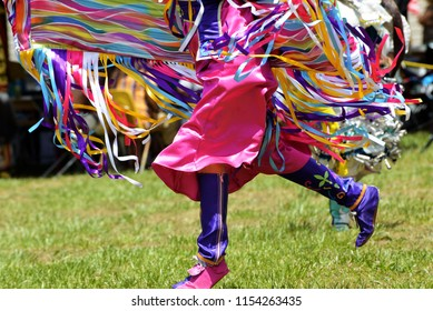 A Native American dancer participates in traditional dances at an annual Pow Wow gathering.