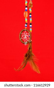 Native American Dreamcatcher is spiritually significant symbol.  Beaded artwork with feathers, shells and leather.