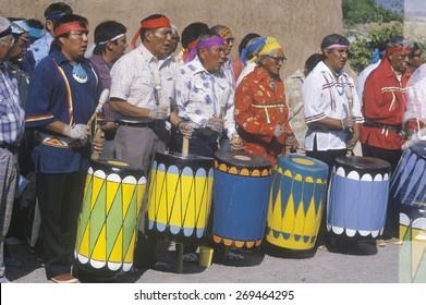 Native American elders drumming during Corn Dance ceremony in Santa Clara Pueblo, NM