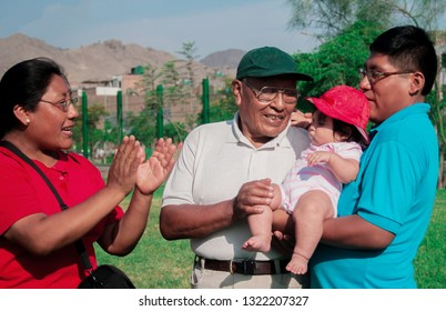 Native american family of three generations having good time in the summer park.