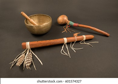 Native American Flute with Feathers and Beaded Shaker with Tibetan Singing Bowl and Ringing Stick.