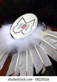 Native American headdress decorated with traditional symbols
