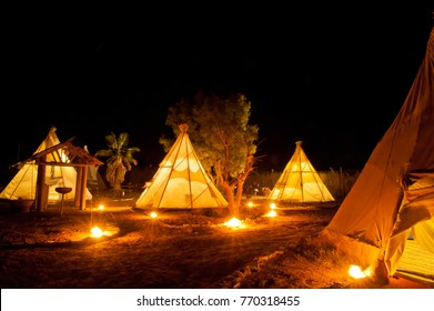 Native American Indian tent at night at the desert