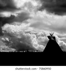 Native American landscape. North American Indian Tepee silhouette against a turbulent dramatic sky . Black and white