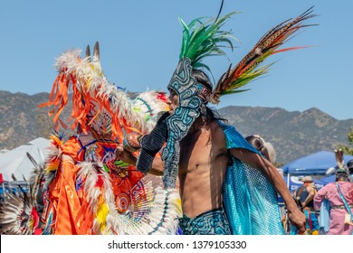 A native American man in full regalia dances at 2019 21st Annual Chumash Day Powwow and Intertribal Gathering, Malibu, California, April 13, 2019