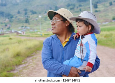 Native american man with his little child in the countryside.