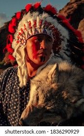 Native American man at sunset outdoor in the steppe