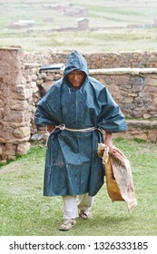 Native american man wearing raincoat in the countryside.