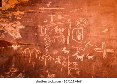 Native American petroglyphs - art drawings, estimated to be over 4000 years old, at Atlatl Rock, Valley of Fire State Park, Nevada, USA