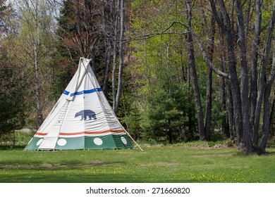 Native American Tepee at Forest Edge - Indian tepee in upper Midwest USA State Park.  Bear clan symbol on tent.