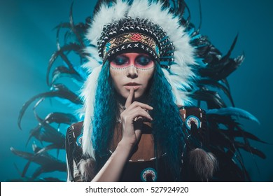 Native American woman with a finger at her mouth