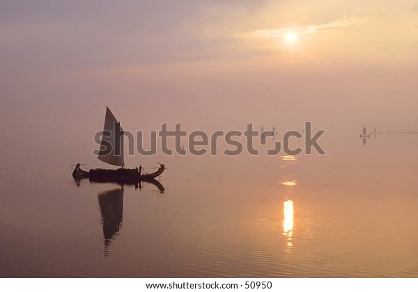 Native boat sailing on Ganges river in India