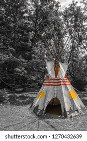 Native Canadian Indian Tipi featuring canvass with vivid yellow and red markings