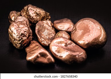 native copper nuggets isolated on black background, ore for industrial use in electrical wires and household utensils
